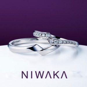 俄 綾 結婚指輪 クロスした個性的なデザイン